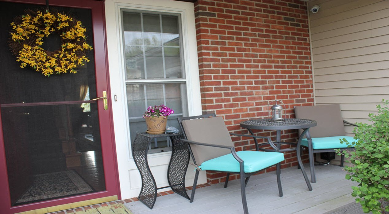 small front porch transformed with a patio bistro set. Black Bedroom Furniture Sets. Home Design Ideas
