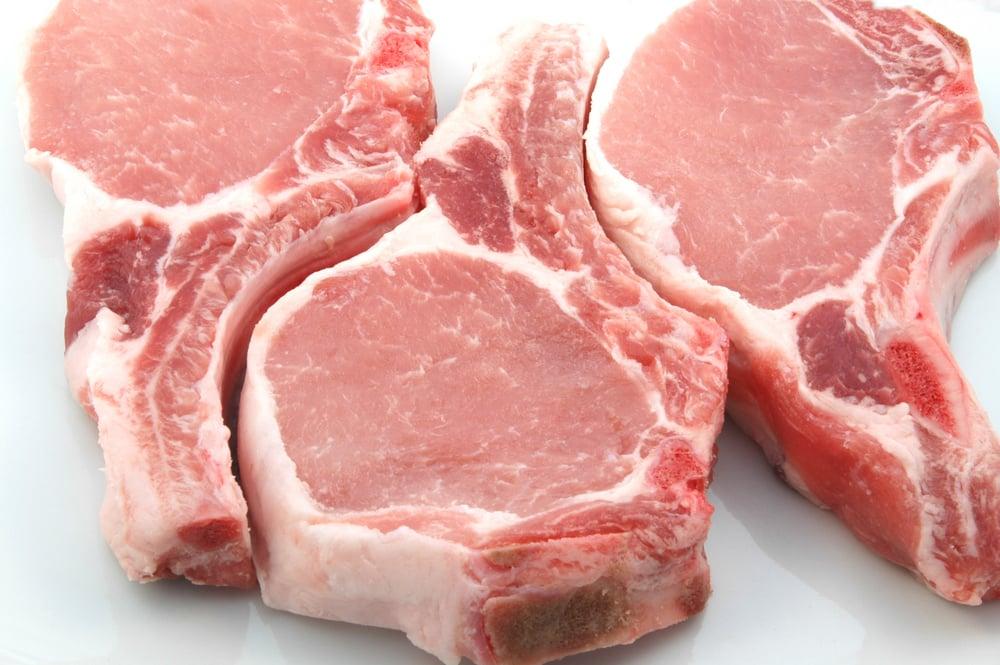 plump center cut pork chops on white