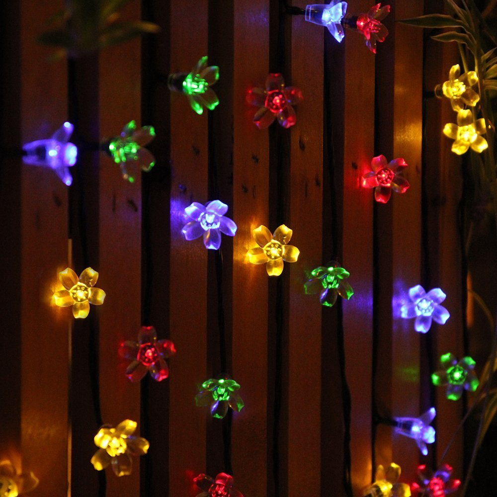 how to brighten your outdoor space with solar powered string lights. Black Bedroom Furniture Sets. Home Design Ideas