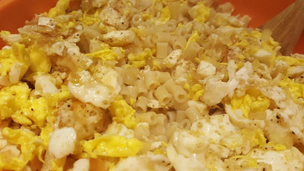 pasta, eggs, onion and garlic in oil
