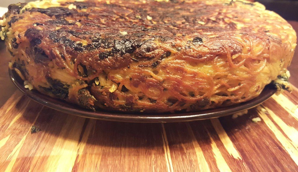 Spaghetti Pie With Spinach Onions And Cheese