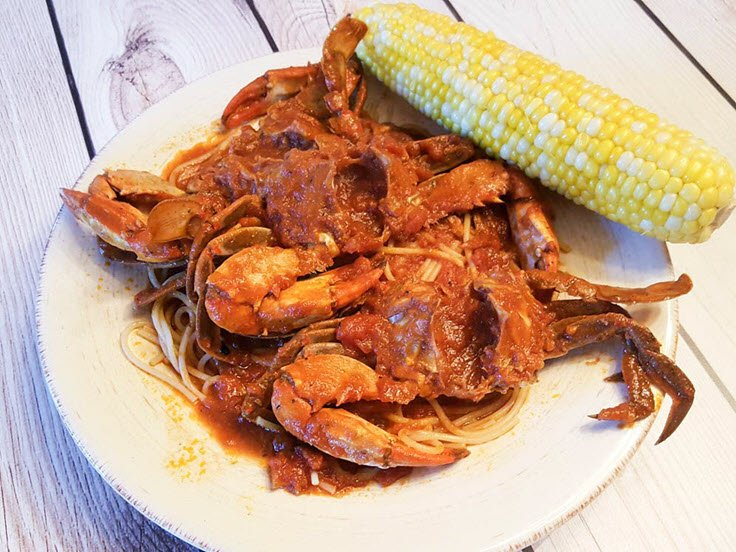 Fried Blue Stone Crabs In Savory Tomato Sauce Over Pasta Recipe