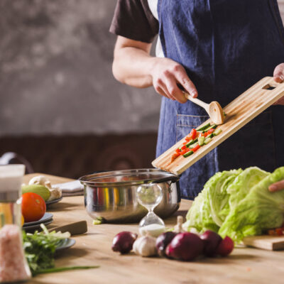 crop-couple-cooking-salad-together