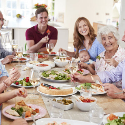 family enjoying healthy dinner together FEATURED