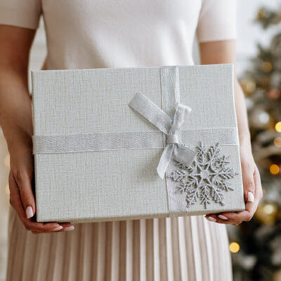 girl-holding-beautiful-box-with-christmas-gift-featured