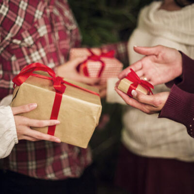 hands-people-exchanging-presents-christmas-FEATURED