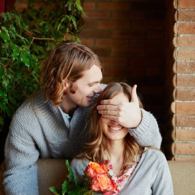 man-giving-bouquet-kiss-his-wife