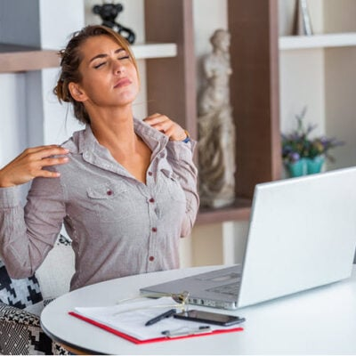 stressed-woman-suffering-from-back-pain-after-working-pc-FEATURED