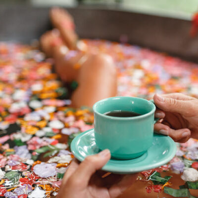 woman-bath-soaking-cup-coffee-featured
