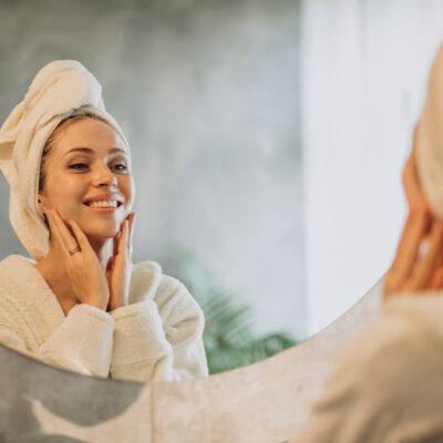 woman-home-applying-cream-mask