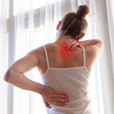 young-woman-suffering-from-neck-pain-backache-stretching-muscles-home-back-neck-pain-woman FEATURED